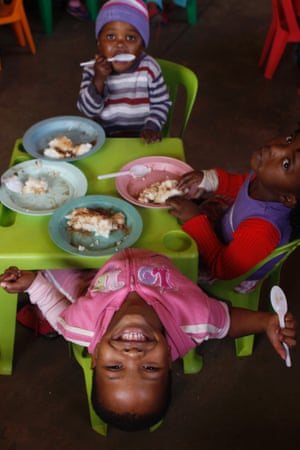Children have a meal at a play centre at the Dube hostel in Soweto South Africa. The centre is provided with educational toys from Cotlands, a local non-profit organization that promotes early learning opportunities for children. Cotlands first opened it's doors 77 years ago offering adoption services for abandoned babies.