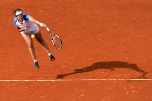 Portugal's Maria Joao Koehler serves to France's Alize Cornet (unseen) during their French Tennis Open first round match at the Roland Garros stadium in Paris. Photograph: Miguel Medina/AFP/Getty Images