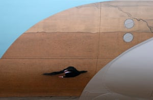 A member of the U.S Secret Service is reflected in the side of Air Force One at McGuire Air Force Base. President Barack Obama and New Jersey Gov. Chris Christie left for an appearance at Asbury Park, one of the many Jersey shore communities devastated by Super Storm Sandy. Photograph: Rich Schultz/AP