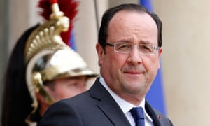 France's President Hollande waits for a guest on the steps of the Elysee Palace in Paris