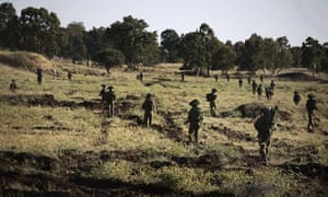 Israeli soldiers take part in exercises in the Golan Heights