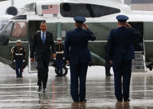 U.S. President Barack Obama walks from Marine One in the rain at McGuire Air Force Base in New Jersey.