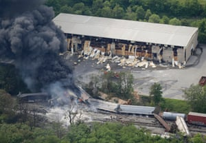 A fire burns at the site of a CSX freight train derailment, in White Marsh, Maryland. Fire officials say the train crashed into a trash truck, causing an explosion that rattled homes at least a half-mile away and collapsed nearby buildings, setting them on fire. Photograph: Patrick Semansky/AP