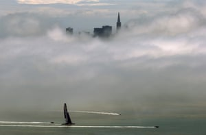 The Oracle AC72 America's Cup catamaran sails on the San Francisco Bay under a blanket of fog as seen from Sausalito, California.