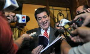 Paraguayan President-elect Horacio Cartes speaks with journalists following a meeting with the European Union observers who gave him the final report on the April 21 elections, in Asuncion.