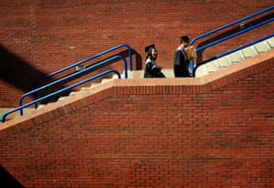 Golda and Meiji Nguyen leave James Brown Arena after graduating from Davidson Fine Arts School in Augusta, United states.