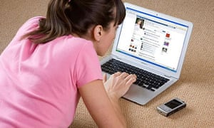 Young woman looking at Facebook