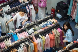 Women shop for discounted fashion at a retail center, in Beijing, China, 29 May 2013. As China's leaders attempt to rebalance the economy, raising individual consumption is seen as one of the main goals.