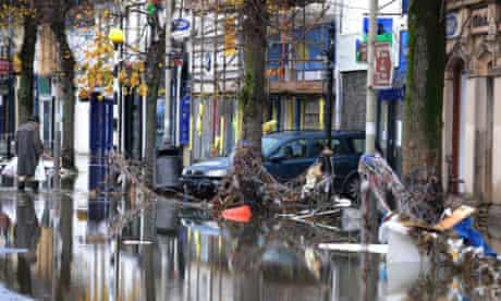 flooded street with car
