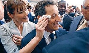 Carla Bruni dabs Nicolas Sarkozy