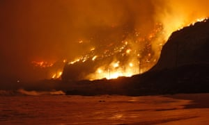 A wind-driven wildfire has been raging along the California coast north of Los Angeles and has prompted the evacuation of hundreds of homes.