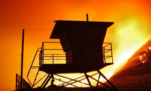 A lifeguard tower stands on the beach at Point Mugu State Park wildfires continue to ravage Southern California.