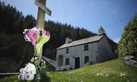 Tributes to April Jones outside the former home of Mark Bridger in Ceinws, near Machynlleth