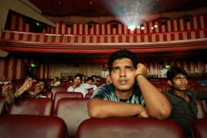 24 hours in pictures: Mumbai, India: People watch a bollywood film at a cinema