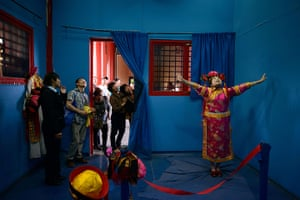 24 hours in pictures: A woman wearing traditional Chinese dress as part of an interactive feature