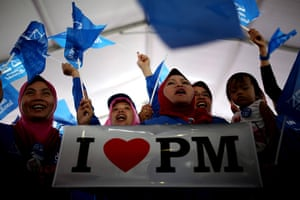 24 hours in pictures: Supporters shout slogans and wave flags as Malaysia's premier Najib Razak