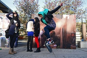 24 hours in pictures: A girl pops an ollie on her skateboard as Afghan youths gather