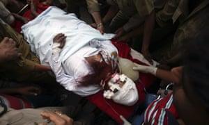 Police and hospital staff transfer Sanaullah Haq, a Pakistani prisoner, to a hospital in Jammu