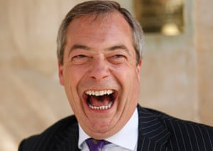A merry Nigel Farage talks to the press as he leaves the pub
