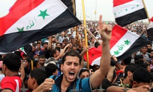 Sunni protesters attend an anti-government demonstration in Fallujah, Iraq
