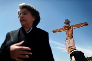 Worshippers pay homage to a giant wooden crucifix during an Orthodox Good Friday ceremony at the Pendeli Monastery, near Athens, Greece.