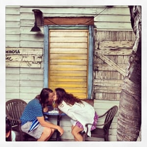 A happy couple kiss over breakfast at Blue Heaven, Key West.