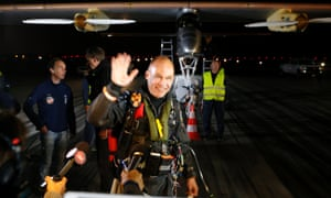 Pilot Bertrand Piccard waves goodbye before taking off in the Solar Impulse solar electric airplane. Pilots Bertrand Piccard and Andre Borschberg are attempting the first cross-continental flight in a solar powered plane that can travel day and night