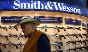 An attendee walks through the Smith and Wesson booth during the 2013 NRA Annual Meeting and Exhibits at the George R. Brown Convention Centre in Houston, Texas.  More than 70,000 peope are expected to attend the NRA's 3-day annual meeting that features nearly 550 exhibitors, gun trade show and a political rally.