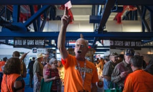 Tommy Joost holds up a raffle ticket to win a gun during the National Rifle Association annual meeting.
