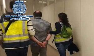 Arthur Budovsky under police guard after his arrest in Spain.