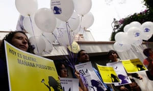 Rights groups protest outside the El Salvador embassy in Mexico City to support abortion request
