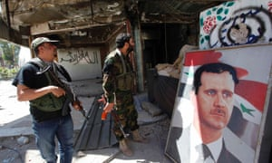 Security personnel loyal to Syria's president Bashar al-Assad take positions in Damascus on 27 May 2013.