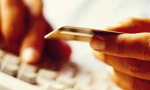 Man shopping on internet, entering credit card number