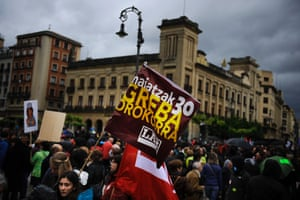 A demonstrator holds a flag reading in Basque language, 'General Strike, May 30',  during the general strike in  Pamplona, northern Spain on Thursday, May 30, 2013.