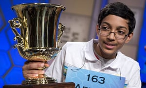 Arvind Mahankali, 13, with his Scripps National Spelling Bee trophy