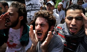 Syrians living in Malaysia shout slogans during a rally against Syria's President Bashar al-Assad and foreign intervention in the Syrian crisis, outside the Iranian embassy in Kuala Lumpur.