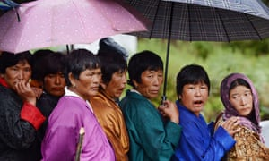 Bhutanese villagers stand in line while waiting to vote at a polling station in Paro. Bhutan begins its second ever parliamentary election today, after polling officials trekked for up to seven days to reach voters in the most remote corners of the Himalayan kingdom.