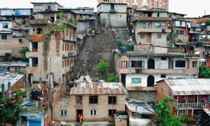 The aftermath of a landslide caused by torrential rain at a landless squatters' settlement in Kathmandu. A 15-year-old boy was reportedly killed and two others were injured by the landslide which caused damage to four houses in the area.