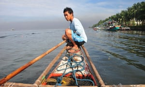 A fisherman sets out to join a protest in Manila Bay in the Philippines. More than 40 fishing boats and 400 participants from various towns surrounding Manila Bay joined the early morning protest calling on the current administration to save the livelihoods of fishers and their families, which are at risk from the Manila Bay Reclamation Project and indiscriminate fishing in the bay area.