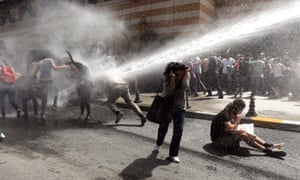 Turkish riot police use water cannons to disperse demonstrators during a protest against the demolition of Taksim Gezi Park in Istanbul. Protesting under the slogan 'OccupyGezi', activists have been staging a demonstration since 28 May to save the park.