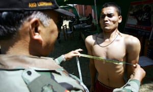 A candidate gets his chest measured during an Indian army recruitment rally in Jammu, Kashmir. Thousands of men attended the rally organised by the army, which has employed nearly half a million of soldiers from the region.