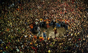 """Revellers surround the """"Nans Vells"""", Catalan for 'old dwarves', during the first day of La Patum festival in Berga, Spain."""