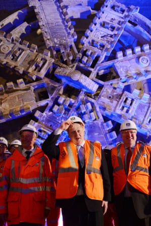 Boris Johnson and transport secretary Patrick McLoughlin (right) mark the breaking through of the 1,000 tonne eastern tunnelling machine, named Elizabeth, into Canary Wharf station as work continues on the Crossrail project in London.