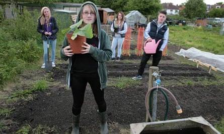 Ebony Murray with Kaitlin, Charlie and Dan on their allotment at Barnett Wood Lane, Leatherhead