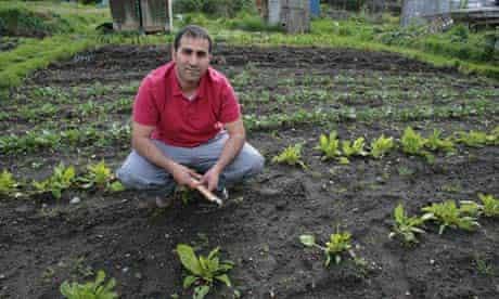 Sait Buyukertas on his plot at Barnett Wood Lane, Leatherhead