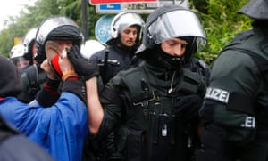 """Protestors use their kitchen equipment to make noise as they scuffle with German riot police in front of the headquarters of Germany's largest business bank, Deutsche Bank AG, during an anti-capitalism """"Blockupy"""" demonstration in Frankfurt, May 31, 2013."""