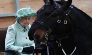 The Queen watches a display of gun carriages during a visit to the King's Troop at Woolwich Barracks in south-east London.