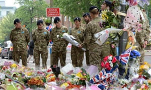 Members of the 14th Regiment Royal Artillery visit the site where Lee Rigby died outside Woolwich Barracks. Photograph: Andy Rain/EPA