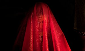 Zareena, a Kashmiri Bakarwal bride, sits inside a temporary camp with her face covered with a scarf during her wedding ceremony on the outskirts of Srinagar, India. Bakarwals are nomadic herders in Jammu Kashmir state, who move around in search of good pastures for their cattle.