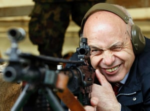 Swiss President Ueli Maurer aims at a target during a shooting exercise with the Foreign Diplomatic Corps in Switzerland in St Ursen near Fribourg. 'Eidgenoessisches Feldschiessen', the annual shooting skills exercise, is a several hundred-year-old tradition attended by some 120,000 marksmen throughout Switzerland.